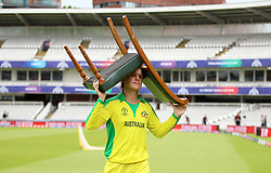 Australia's Adam Zampa carries his chair back to the pavillion during a nets session at Lord's, London.