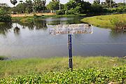Danger sign warning of deep water Pasikudah Bay, Eastern Province, Sri Lanka, Asia