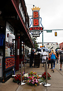 Fans paid their respects to B.B. King outside of this Memphis Blues Club by laying flowers on the musical note dedicated to him on Beale Street in Memphis. B.B. was a nick name given to him on Beale Street. B.B. His nick name was Beale Street Blues Boy. The Mississippi-born legend died peacefully in his sleep at 11:40 p.m on Thursday night. King made a name for himself as a young man, as a blues artist on Beale Street in Memphis, where he later opened a name sake club.