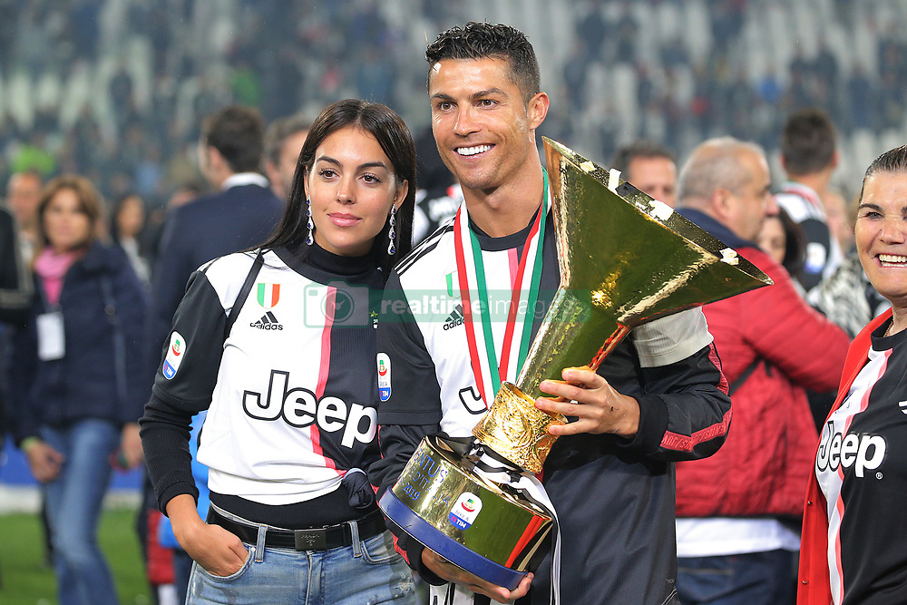 May 19, 2019 - Turin, Turin, Italy - Cristiano Ronaldo #7 of Juventus FC and Georgina Rodriguez celebrate with the trophy after winning the Serie A Championship at the end of the serie A match between Juventus FC and Atalanta BC at Allianz Stadium on May 19, 2019 in Turin, Italy. (Credit Image: © Giuseppe Cottini/NurPhoto via ZUMA Press)