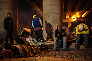 A group of migrants gather beside train tracks under a bridge near to Mexico City where they have to bear the cold at dawn and be alert when train is getting close, in State of Mexico, Mexico, September 20, 2008.
