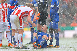 Stoke City's Charlie Adam helps up Everton's Wayne Rooney after a foul during the Premier League match at the bet365 Stadium, Stoke.