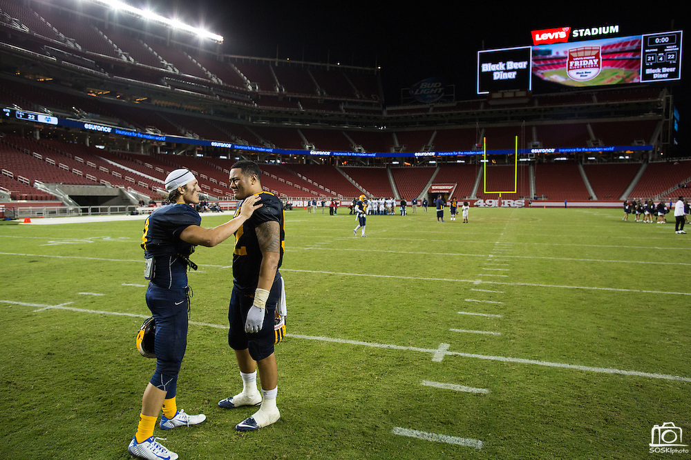 Milpitas fullback Michael Pyle, 8, left, consults an unidentified player, 52, in tears after losing to Valley Christian High School , 22-21, during Friday Night Lights at Levi's Stadium in Santa Clara, California, on September 18, 2015. (Stan Olszewski/SOSKIphoto)