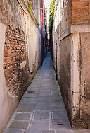A narrow passage between palazzos, in Venice, Italy