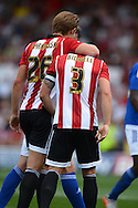 James Tarkowski of Brentford with Jake Bidwell, the Brentford captain (3). Skybet football league Championship match, Brentford v Ipswich Town at Griffin Park in London on Saturday 8th August 2015.<br /> pic by John Patrick Fletcher, Andrew Orchard sports photography.