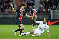 FOOTBALL - FRENCH CHAMPIONSHIP 2011/2012 - L1 - PARIS SAINT GERMAIN v DIJON FCO  - 23/10/2011 - PHOTO JEAN MARIE HERVIO / DPPI - JAVIER PASTORE (PSG) / DAMIEN MARCQ (DIJ)