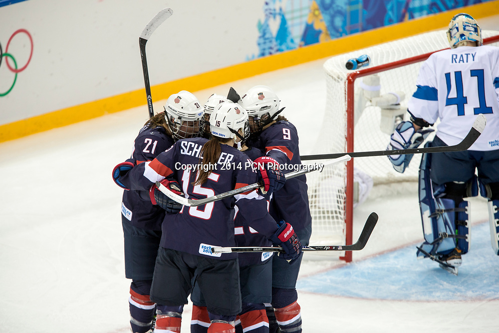 Team USA celebrates after Kelli Stack (USA) scores during ice hockey game vs FIN at the Olympic Winter Games, Sochi 2014