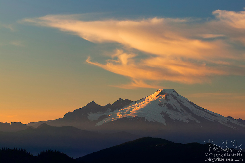 A wave of cirrus clouds seems to come from the cone of Mount Baker, one of five volcanoes in Washington state. This view of the 10,781-foot mountain was captured from the summit of North Mountain near Darrington..