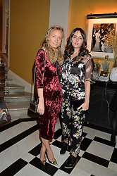 Left to right, MARTHA WARD and TANIA FARES at the Claridge's Christmas Tree By Dolce & Gabbana Launch Party held at Claridge's, Brook Street, London on 26th November 2013.