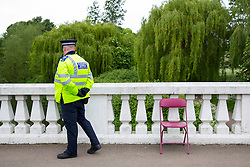 © licensed to London News Pictures. London, UK 07/05/2014. Police officers investigating an area in Crane Park, west London where a 18-year-old man has been stabbed to death on 6 May 2014. Photo credit: Tolga Akmen/LNP