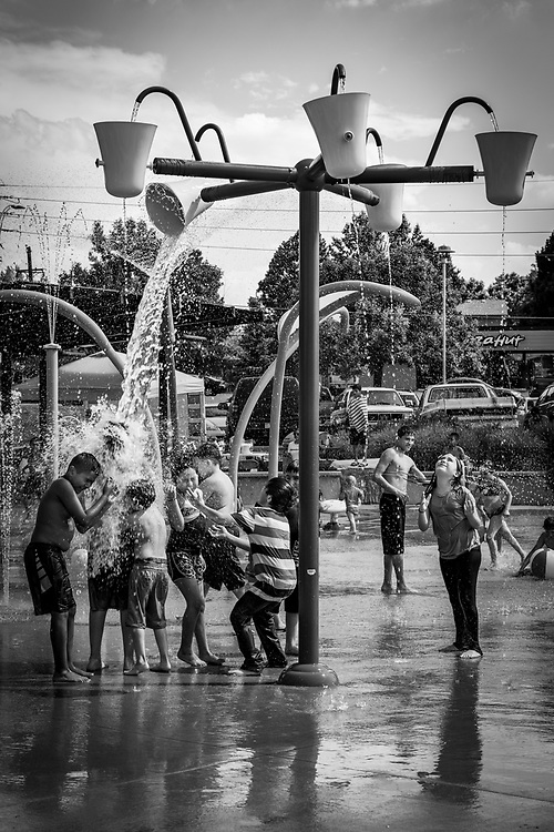 Kids play in the water park.