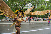 A woman with golden moth-like wings on 5th Avenue.