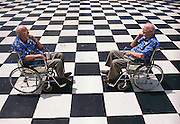 "Colombo, Sri Lanka. Sir Arthur C. Clarke sits in his wheelchair (he has post-polio syndrome) at the Galle Face Hotel in Colombo, Sri Lanka, upon a checkerboard-patterned area facing the sea. Clarke wrote 3001 while living in this hotel. He wrote 2001 while living in the Chelsea Hotel in New York City. When asked about Hal and Hal's legacy (artificial intelligence), Clarke said that Hal was possible but asked if that was a good idea. He said that he believed intelligent machines will come, but then there is the question of consciousness. ""I think, therefore I am, I think,"" he said. The photograph Illustrates this quote. Published in Germany's Stern Magazine, 12 December 2001, pages 74-75 and table of contents. (He has post-polio syndrome) Best known for the book 2001: A Space Odyssey. MODEL RELEASED"