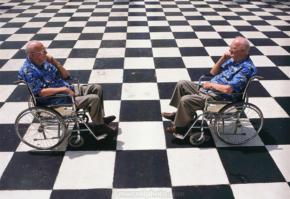 """Colombo, Sri Lanka. Sir Arthur C. Clarke sits in his wheelchair (he has post-polio syndrome) at the Galle Face Hotel in Colombo, Sri Lanka, upon a checkerboard-patterned area facing the sea. Clarke wrote 3001 while living in this hotel. He wrote 2001 while living in the Chelsea Hotel in New York City. When asked about Hal and Hal's legacy (artificial intelligence), Clarke said that Hal was possible but asked if that was a good idea. He said that he believed intelligent machines will come, but then there is the question of consciousness. """"I think, therefore I am, I think,"""" he said. The photograph Illustrates this quote. Published in Germany's Stern Magazine, 12 December 2001, pages 74-75 and table of contents. (He has post-polio syndrome) Best known for the book 2001: A Space Odyssey. MODEL RELEASED"""