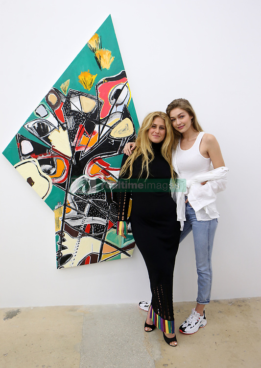 """EXCLUSIVE: Supermodel Gigi Hadid and her brother Anwar attend an art gallery opening in Miami. The opening was for Gigi's good friend, artist Austin Weiner, of whom the model already owns several artworks. Gigi and her brother, as well as many other Miami socialites and fellow artists, enjoyed wine while checking out the artists' latest body of work entitled """"Mid-Explosion"""". The event took place at the Bill Brady Gallery in Miami. 24 Nov 2018 Pictured: Austin Weiner; Gigi Hadid. Photo credit: MEGA TheMegaAgency.com +1 888 505 6342"""