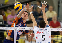 Alen Sket of ACH vs Osmany Portuondo Juantorena of Trentino at 2nd Semifinal match of CEV Indesit Champions League FINAL FOUR tournament between ACH Volley, Bled, SLO and Trentino BetClic Volley, ITA, on May 1, 2010, at Arena Atlas, Lodz, Poland. (Photo by Vid Ponikvar / Sportida)