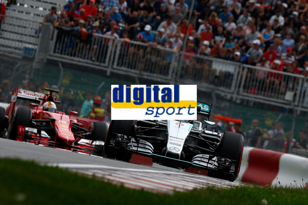 ROSBERG nico (ger) mercedes gp mgp w06 action<br /> VETTEL sebastian (ger) ferrari sf15t action during the 2015 Formula One World Championship, Grand Prix of Canada from June 05th to 7th 2015,  in Montreal. Photo DPPI.