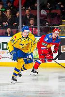 KELOWNA, BC - DECEMBER 18: Pontus Holmberg #29 of Team Sweden skates alongside Nikita Shashkov #18 of Team Russia at Prospera Place on December 18, 2018 in Kelowna, Canada. (Photo by Marissa Baecker/Getty Images)***Local Caption***