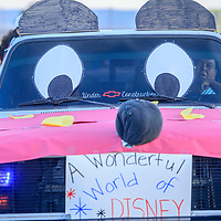 A Chevrolet pickup truck adorned with Micky Mouse ears and eyes joins the parade line for a Disney-themed Disney characters in the Tohatchi High School Homecoming parade in Tohatchi Wednesday.
