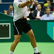 NLD/Rotterdam/20100214 - ABN - AMRO tennistoernooi 2010, finale Michail Joezjni (yellow racket)- Robin Söderling (white/orange shirt)