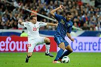 FOOTBALL - FIFA WORLD CUP 2014 - QUALIFYING - FRANCE v BIELORUSSIA - SAINT DENIS (FRANCE) - 11/09/2012 - PHOTO JEAN MARIE HERVIO / REGAMEDIA / DPPI - ETIENNE CAPOUE (FRA) / SIARHEI BALANOVICH (BIE)