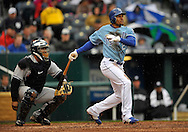 April 12, 2009:  Center fielder Coco Crisp #2 of the Kansas City Royals drives the ball to right field during a game against of the New York Yankees at Kauffman Stadium in Kansas City, Missouri.