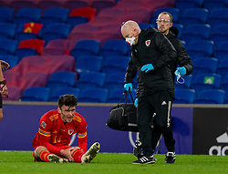 CARDIFF, WALES - Wednesday, November 18, 2020: Wales' Kieffer Moore goes down injured during the UEFA Nations League Group Stage League B Group 4 match between Wales and Finland at the Cardiff City Stadium. Wales won 3-1 and finished top of Group 4, winning promotion to League A. (Pic by David Rawcliffe/Propaganda)