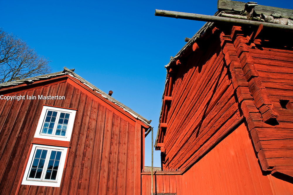 Traditional red wooden farmhouse building at Skansen outdoor museum in Stockholm Sweden 2009