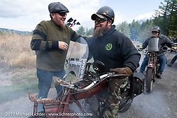 Clint Funderburg is greeted by Jason Sims as he crossed the finish line on his 1916 Indian Powerplus in the Motorcycle Cannonball coast to coast vintage run. Stage 15  (51 miles - the Grand Finish) from The Dalles to Stevenson, OR. Sunday September 23, 2018. Photography ©2018 Michael Lichter.