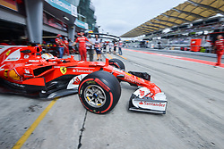 SEPANG, Sept. 29, 2017  Germany's Formula One driver Sebastian Vettel of Ferrari drives out of the pit during the second practice session of the Formula One Malaysia Grand Prix at the Sepang Circuit in Malaysia, on Sept. 29, 2017. (Credit Image: © Chong Voon Chung/Xinhua via ZUMA Wire)