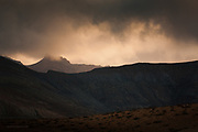 Volcanic landscape, Fuerteventura, Canaries. <br /> <br /> We rarely see any bad weather on this arid island but on this evening, black clouds rolled overhead and the first spots of rain steamed off the hot car windscreen