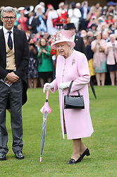 Queen Elizabeth II meets guests during a Royal Garden Party at Buckingham Palace in London.