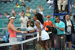 March 22, 2019 - Miami Gardens, Florida, United States Of America - MIAMI GARDENS, FLORIDA - MARCH 22: Serena Williams of the United States Squinting into the late afternoon sun, tried to shield her eyes from the bright light  as she defeats Rebecca Peterson of Sweden on Day 5 of the Miami Open Presented by Itau at Hard Rock Stadium on March 22, 2019 in Miami Gardens, Florida..People: Serena Williams. (Credit Image: © SMG via ZUMA Wire)
