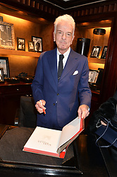 NICKY HASLAM at a party to celebrate the publication of 'A Designer's Life' by Nicky Haslam held at Ralph Lauren, 1 New Bond Street, London on 19th November 2014.