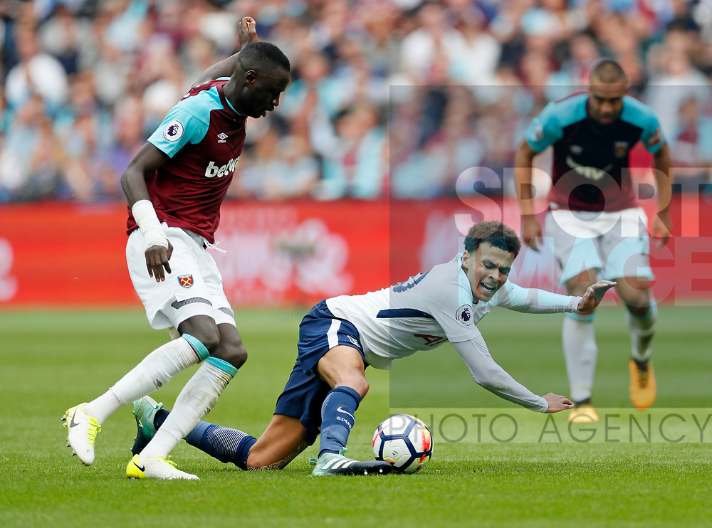 West Ham's Chiekhou Kouyate tussles with Tottenham's Dele Alli during the premier league match at the London Stadium, London. Picture date 23rd September 2017. Picture credit should read: David Klein/Sportimage