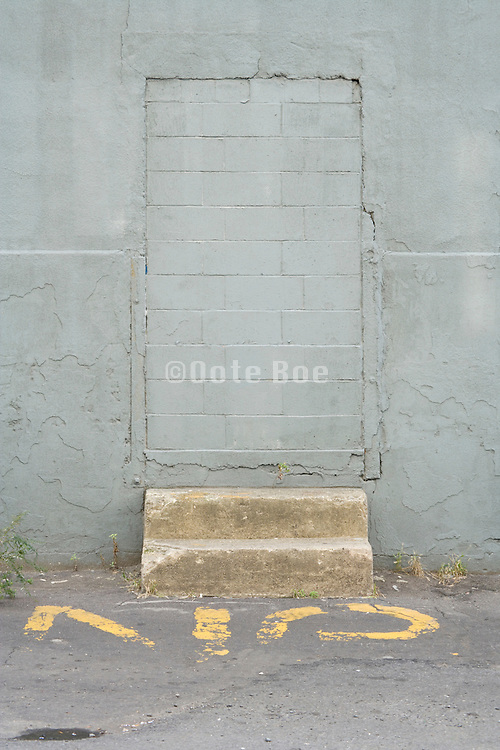 bricked up door opening in wall