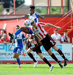 Arron Downes of Cheltenham Town heads clear from Ellis Harrison of Bristol Rovers - Mandatory by-line: Neil Brookman/JMP - 25/07/2015 - SPORT - FOOTBALL - Cheltenham Town,England - Whaddon Road - Cheltenham Town v Bristol Rovers - Pre-Season Friendly