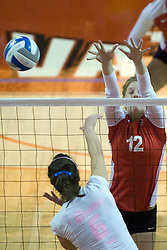 13 October 2012: Emily Schneider blocking during an NCAA volleyball game between the Drake Bulldogs and the Illinois State Redbirds.  The Redbirds won the match in 3 straight sets at Redbird Arena in Normal Illinois