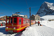 The Jungfrau train at the foot of the Eiger mountain at Kleiner Scheidegg, Swiss Alps .<br /> <br /> Visit our SWITZERLAND  & ALPS PHOTO COLLECTIONS for more  photos  to browse of  download or buy as prints https://funkystock.photoshelter.com/gallery-collection/Pictures-Images-of-Switzerland-Photos-of-Swiss-Alps-Landmark-Sites/C0000DPgRJMSrQ3U