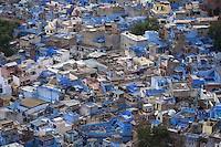 """Jodhpur """"the blue city"""" is the second largest city in  Rajasthan after Jaipur.  The town was formerly the capital of the kingdom known as Marwar. Today Jodhpur is a popular tourist destination, featuring many palaces, forts and temples, set in the stark landscape of the Thar desert.  Jodhpur is often referred to as the """"Blue City"""" due to the vivid blue painted houses around the Mehrangarh Fort and the area known as Brampuri."""