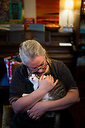 My mother, Rita Krueger, holds her youngest cat named Fergie at home in Philadelphia, Pa. on Friday, January 1, 2021.