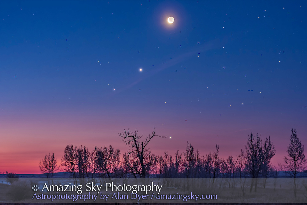 The waning crescent Moon above Venus and Saturn (dimmer and below Venus) in the dawn twilight on January 6, 2016, taken from home on a cold winter morning at -20° C. At right and below the planets are the stars of Scorpius, including Antares just above the trees and the trio of stars for the head of Scorpius at right.<br /> <br /> This is a composite of a long exposure (6s) for the ground, and shorter exposures for the Moon to avoid it being totally overexposed and to preserve the Earthshine. All with the 50mm lens and Canon 60Da.