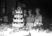 08/10/1959<br /> 10/08/1959<br /> 08 October 1959<br /> Wedding:Kenny - Colgan  (Muriel? and Tommy) at Church of St. Vincent de Paul, Griffith Avenue and the Grand Hotel, Malahide, Dublin. The couple with best man and bridesmaid and the rather impressive wedding cake at he hotel.