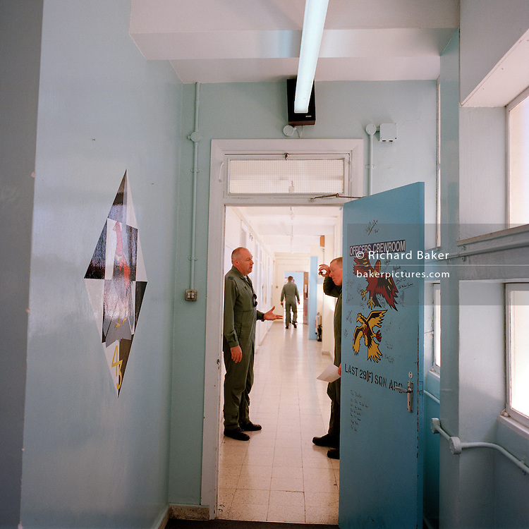Two pilots of the Red Arrows, Britain's RAF aerobatic team in discussion in MoD corridor at RAF Akrotiri.