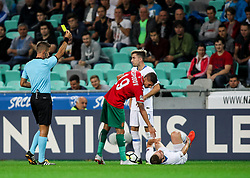 Referee Davide Massa of Italy with yellow card for Kiril Despodov of Bulgaria when he faulted Bojan Jokic of Slovenia during football match between National Teams of Slovenia and Bulgaria in Final Tournament of UEFA Nations League 2019, on September 6, 2018 in SRC Stozice, Ljubljana, Slovenia. Photo by Morgan Kristan / Sportida