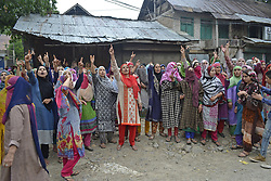 August 2, 2017 - India - Kashmiri villagers shout pro-freedom slogans during  funeral procession of  Akeel Ahmed Bhat, a teenage boy in Haal village, south of Srinagar, Akeel  sustained serious injuries when government force fired pellet and bullets on protester during clashes in hall village ,he later succumbed to  injuries at local hospital in Indian controlled Kashmir. (Credit Image: © Umer Asif/Pacific Press via ZUMA Wire)