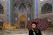 Faith D'Aluisio, one of the authors of the book What I Eat: Around the World in 80 Diets in front of the Imam Mosque in Isfahan, Iran, during a December snow storm. MODEL RELEASED.