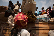 People fleeing to Chad load their belongings on a truck in Bangui January 22, 2014.