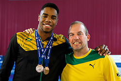 Yona Kinght-Wisdom of Team Jamaica (Guest) poses with his Bronze medals from the Mens 1m Springboard and 3m Springboard Finals, and his City of Leeds Diving Club coach Edwin Jongejans - Photo mandatory by-line: Rogan Thomson/JMP - 07966 386802 - 21/02/2015 - SPORT - DIVING - Plymouth Life Centre, England - Day 2 - British Gas Diving Championships 2015.