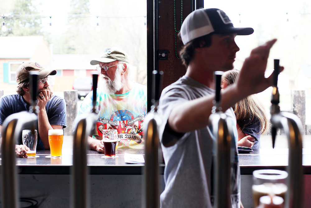 Mike Donahue, left, and Dennis Meyer enjoy an afternoon pint at 10 Barrel Brewing Company. Craft beer permeates the culture in Central Oregon city of Bend, with 10 breweries serving pints, growlers and kegs to a community of less than 90,000. Photographed Wednesday, April 25, 2012. Assignment ID 30125094A